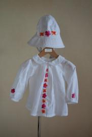 Barnklänning med orange/cerise blommor